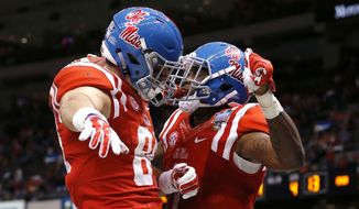 Mississippi wide receiver Laquon Treadwell (1) celebrates his touchdown reception with tight end Hunter Thurley (84) in the second half of the Sugar Bowl college football game against Oklahoma State in New Orleans, Friday, Jan. 1, 2016. (AP Photo/Jonathan Bachman)