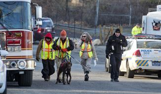 A search crew heads out from the command center Saturday, Jan. 2, 2016, in Allentown, Pa., as the search continues for Jayliel Vega Batista, a missing 5-year-old autistic boy who wandered off from a New Year's Eve party on Thursday night. (Chris Shipley/The Morning Call via AP)