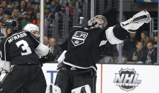Los Angeles Kings goalie Jonathan Quick reaches for the puck during the first period of an NHL hockey game against the Philadelphia Flyers, Saturday, Jan. 2, 2016, in Los Angeles. (AP Photo/Jae C. Hong)