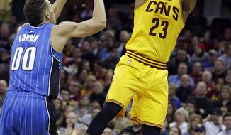 Cleveland Cavaliers' LeBron James (23) shoots over Orlando Magic's Aaron Gordon (00) in the second half of an NBA basketball game Saturday, Jan. 2, 2016, in Cleveland. The Cavaliers won 104-79. (AP Photo/Tony Dejak)