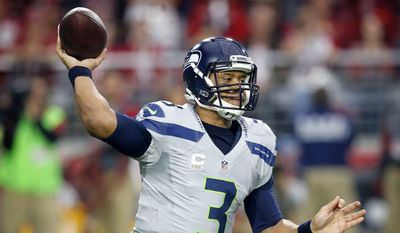 Seattle Seahawks quarterback Russell Wilson (3) throws against the Arizona Cardinals during the first half of an NFL football game, Sunday, Jan. 3, 2016, in Glendale, Ariz. (AP Photo/Ross D. Franklin)