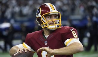 Washington Redskins' Kirk Cousins (8) throws a pass as he warms up before an NFL football game against the Dallas Cowboys on Sunday, Jan. 3, 2016, in Arlington , Texas. (AP Photo/Michael Ainsworth)