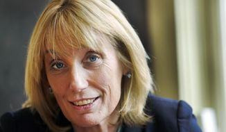 FILE - In this Monday, Oct. 5, 2015, file photo, Gov. Maggie Hassan, D-N.H., poses at the governor's mansion, Bridges House, in Concord, N.H. In 2016, Hassan will balance her duties as governor with her bid for the U.S. Senate. (AP Photo/Jim Cole, File)