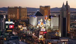 FILE - In this Oct. 20, 2009 file photo, casinos are pictured on the Las Vegas Strip. Tourism officials said 42 million people visited Las Vegas in 2015, an all-time record for Sin City that continues to recover from the hard-hitting recession of several years ago. (AP Photo/Isaac Brekken, File)