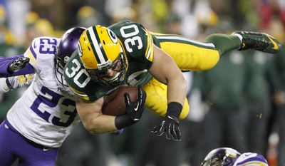 Green Bay Packers' John Kuhn is stopped on a run during the second half an NFL football game against the Minnesota Vikings Sunday, Jan. 3, 2016, in Green Bay, Wis. (AP Photo/Matt Ludtke)