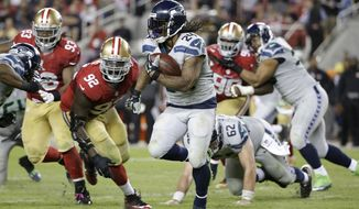 FILE - In this Oct. 22, 2015, file photo, Seattle Seahawks running back Marshawn Lynch (24) runs against San Francisco 49ers defensive end Quinton Dial (92) during the second half of an NFL football game in Santa Clara, Calif. Marshawn Lynch has rejoined the Seattle Seahawks just in time for the playoffs. Coach Pete Carroll said on his radio show Monday morning, Jan. 4, 2016,  that Lynch was back at the team's facility after missing the final seven games of the regular season and undergoing abdominal surgery.  (AP Photo/Marcio Jose Sanchez, File)