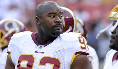 FILE - In this Aug. 21, 2010, file photo, Washington Redskins defensive lineman Albert Haynesworth looks on before an NFL preseason football game against Baltimore Ravens in Landover, Md. People with knowledge of the negotiations say that the Washington Redskins and the Tennessee Titans are in discussions about a trade of disgruntled defensive tackle Albert Haynesworth. The people spoke to The Associated Press on Tuesday, Sept. 7, 2010, on condition of anonymity because the talks are confidential. Washington signed Haynesworth to a $100 million contract in 2009 as a free agent, and the tackle accepted a $21 million bonus in April.   (AP Photo/Susan Walsh, File)