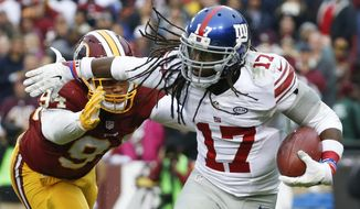 New York Giants wide receiver Dwayne Harris (17) pushes Washington Redskins linebacker Preston Smith (94) back during the second half of an NFL football game in Landover, Md., Sunday, Nov. 29, 2015. (AP Photo/Alex Brandon)