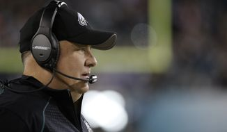 FILE- In this Dec. 26, 2015, file photo, Philadelphia Eagles head coach Chip Kelly watches from the sidelines before an NFL football game against the Washington Redskins in Philadelphia. Kelly, Adam Gase and Mike Shanahan are just a few of the hot names for teams looking for a new head coach. (AP Photo/Michael Perez, File)