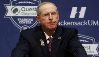 Former New York Giants head coach Tom Coughlin speaks during a news conference, Tuesday, Jan. 5, 2016, in East Rutherford, N.J. (AP Photo/Julio Cortez)
