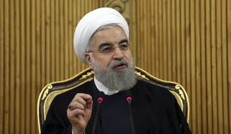 Iranian President Hassan Rouhani briefs media upon his arrival from the U.S. at Mehrabad airport in Tehran, Iran, in this Sept. 29, 2015, file photo. (AP Photo/Ebrahim Noroozi, File)