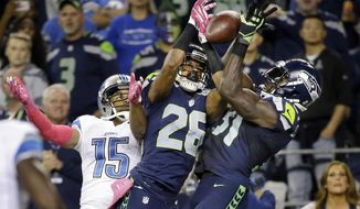 FILE - In this Oct. 5, 2015, file photo, Seattle Seahawks strong safety Kam Chancellor, right, and cornerback Cary Williams (26) break up a pass intended for Detroit Lions wide receiver Golden Tate (15) in the second half of an NFL football game, in Seattle. Williams' agent said the cornerback has agreed to sign with the Washington Redskins. Williams was released by the Seahawks last month and is expected to be available for Washington's wild-card game Sunday, Jan. 10, 2016, against the Green Bay Packers. (AP Photo/Elaine Thompson, File)