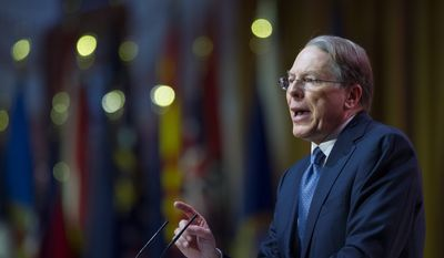 Wayne LaPierre, executive vice president and CEO of the National Rifle Association, decried President Obama's move to increase gun background checks. The NRA has refused to participate in Mr. Obama's gun violence town hall scheduled for Thursday. (Associated Press)