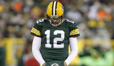 Green Bay Packers' Aaron Rodgers walks off the field during the second half an NFL football game against the Minnesota Vikings Sunday, Jan. 3, 2016, in Green Bay, Wis. (AP Photo/Matt Ludtke)