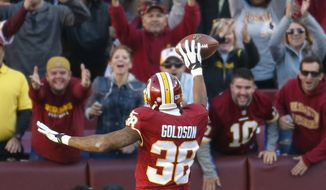 Washington Redskins free safety Dashon Goldson (38) celebrates his touchdown with the fans during the second half of an NFL football game against the New Orleans Saints in Landover, Md., Sunday, Nov. 15, 2015. (AP Photo/Evan Vucci)