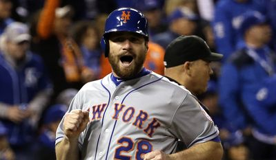 FILE - In this Oct. 28, 2015 file photo, New York Mets' Daniel Murphy reacts as he scores in Game 2 of the Major League Baseball World Series against the Kansas City Royals,  in Kansas City, Mo. On Wednesday, Jan. 6, 2016, The Washington Nationals agreed to three-year contract with Murphy. (AP Photo/David J. Phillip, File)