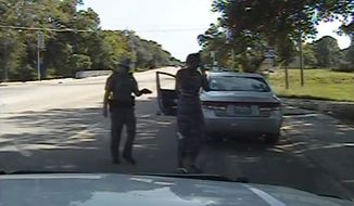 In this image made from dashcam video provided the the Texas Department of Public Safety, state trooper Brian Encinia arrests Sandra Bland after a routine traffic stop in Waller County, Texas, on July 10, 2015. (Texas Department of Public Safety via Associated Press)