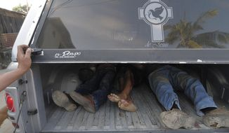 FILE - In this Dec. 5, 2010 file photo, the bodies of three men lie in the back of a funeral home's pick-up truck after they were killed by unidentified gunmen in the Pacific resort city of Acapulco, Mexico. A new study published on Tuesday, Jan. 5, 2016 in the American journal Health Affairs suggests that Mexico's drug violence was so bad at its peak, from 2005-2010, that it apparently caused the nation's male life expectancy to drop by several months. (AP Photo/Bernandino Hernandez, File)