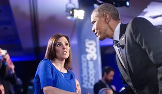 President Obama greets Taya Kyle, widow of Navy SEAL Chris Kyle and gun rights advocate, during a commercial break at a CNN town hall meeting. (Associated Press)