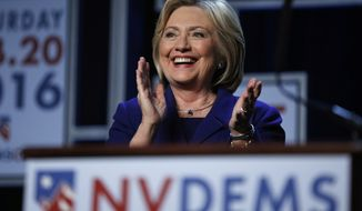 Democratic presidential candidate Hillary Clinton stands on stage at the Battle Born Battleground First in the West Caucus Dinner, Wednesday, Jan. 6, 2016, in Las Vegas. (AP Photo/John Locher)