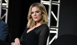 """Khloe Kardashian participates in the panel for """"Kocktails with Khloe"""" at the FYI 2016 Winter TCA on Wednesday, Jan. 6, 2016, in Pasadena, Calif. Kardashian says former NBA star Lamar Odom is doing well in his recovery from an apparent drug overdose last year in a Nevada brothel.  (Photo by Richard Shotwell/Invision/AP)"""