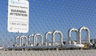 FILE - In this Nov. 3, 2015 file photo, the Keystone Steele City pumping station, into which the planned Keystone XL pipeline is to connect to, is seen in Steele City, Neb.  TransCanada filed a federal lawsuit in Houston on Wednesday, Jan. 7, 2016  alleging President Barack Obama's decision in November to kill the pipeline exceeded his power under the U.S. Constitution.  (AP Photo/Nati Harnik, File)