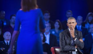 President Barack Obama, right, listens to a question from Taya Kyle, left, widow of U.S. Navy SEAL Chris Kyle, during a CNN televised town hall meeting hosted by Anderson Cooper at George Mason University in Fairfax, Va., Thursday, Jan. 7, 2016. Obama's proposals to tighten gun controls rules may not accomplish his goal of keeping guns out of the hands of would-be criminals and those who aren't legally allowed to buy a weapon. In short, that's because the conditions he is changing by executive action are murkier than he made them out to be. (AP Photo/Pablo Martinez Monsivais)