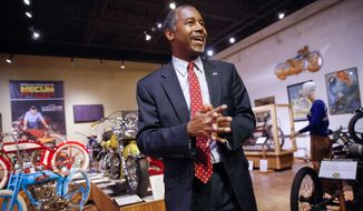 Republican presidential candidate, Dr. Ben Carson walks through the National Motorcycle Museum in Anamosa, Iowa, Thursday, Jan. 7, 2016, after holding a town hall. (AP Photo/Patrick Semansky)