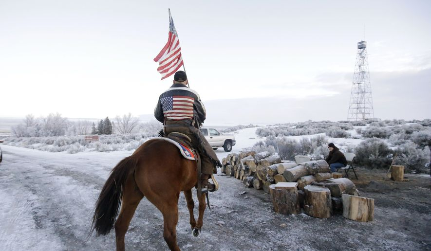 Cowboy Dwane Ehmer, of Irrigon Ore., a supporter of the group occupying the Malheur National Wildlife Refuge, rides his horse at Malheur National Wildlife Refuge Friday, Jan. 8, 2016, near Burns, Ore. Three Oregon sheriffs met with leaders of an armed group to try to persuade them to end their occupation of the federal wildlife refuge after many local residents made it plain that's what they want. (AP Photo/Rick Bowmer)