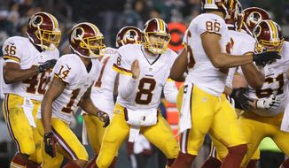 Washington Redskins quarterback Kirk Cousins, once Robert Griffin III's longtime backup, took the reins as starter in August and will lead the team on Sunday into the playoffs for the first time in three years. (Associated Press)