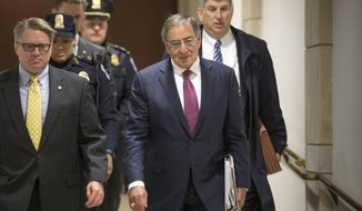 Former Defense Secretary Leon Panetta, center, is escorted to a secure floor on Capitol Hill in Washington, Friday, Jan. 8, 2016, to be questioned in a closed-door hearing of the House Benghazi Committee. The panel, chaired by Rep. Trey Gowdy, R-S.C., is investigating the 2012 attacks on the U.S. consulate in Benghazi, Libya, where a violent mob killed four Americans, including Ambassador Christopher Stevens. (AP Photo/J. Scott Applewhite)