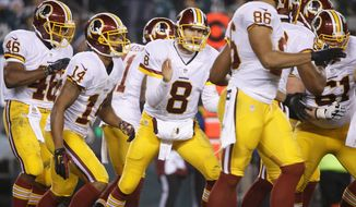 LEADING THE CHARGE: Washington Redskins quarterback Kirk Cousins, once Robert Griffin III's longtime backup, took the reins as starter in August and will lead the team on Sunday into the playoffs for the first time in three years. (Associated Press)