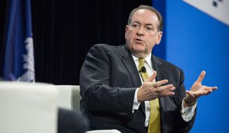 Then-Republican presidential candidate Mike Huckabee speaks with moderators at an economic forum, Saturday, Jan. 9, 2016, in Columbia, S.C. (AP Photo/Sean Rayford) **FILE**