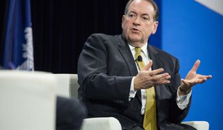Republican presidential candidate Mike Huckabee speaks with moderators at an economic forum, Saturday, Jan. 9, 2016, in Columbia, S.C.   The conference Saturday comes as Republicans try to improve their standing among poorer Americans. (AP Photo/Sean Rayford) **FILE**