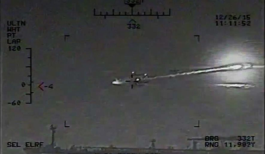 """This image made from video released by the U.S. Navy on Saturday, Jan. 9, 2016 shows the view from a Seahawk helicopter in the Strait of Hormuz on Dec. 26, 2015. The U.S. Navy says the video shows a rocket fired from an Iranian Revolutionary Guard vessel near warships and commercial traffic in the strategic strait. What appears to be an oil tanker is seen in the foreground. Previously an Iranian Revolutionary Guard spokesman had denied conducting any naval drills at the time and called the American accusations """"psychological warfare."""" (U.S. Navy via AP)"""