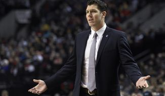Golden State Warriors assistant coach Luke Walton gestures during the first half of the team's NBA basketball game against the Portland Trail Blazers in Portland, Ore., Friday, Jan. 8, 2016. (AP Photo/Steve Dykes)
