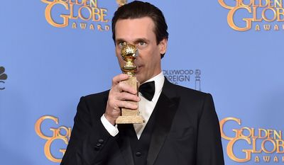 "Jon Hamm poses in the press room with the award for best performance by an actor in a TV series - drama for ""Mad Men"" at the 73rd annual Golden Globe Awards on Sunday in Beverly Hills, Calif. (Associated Press)"