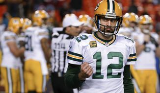 Green Bay Packers quarterback Aaron Rodgers pumps his fist as he walks off the field in the closing minutes of the team's NFL wild-card playoff football game against the Washington Redskins in Landover, Md., Sunday, Jan. 10, 2016. The Packers won 35-18. (AP Photo/Alex Brandon)