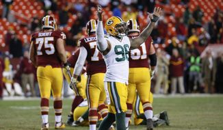 Green Bay Packers outside linebacker Mike Neal (96) celebrates as he walks off the field in the closing minutes of an NFL wild-card playoff football game against the Washington Redskins in Landover, Md., Sunday, Jan. 10, 2016. The Packers won 35-18. (AP Photo/Alex Brandon)