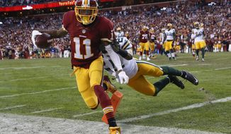 Washington Redskins wide receiver DeSean Jackson (11) is knocked out of bounds by Green Bay Packers free safety Ha Ha Clinton-Dix (21) just short of the touchdown during the first half of an NFL wild card playoff football game in Landover, Md., Sunday, Jan. 10, 2016. (AP Photo/Alex Brandon)