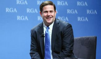 Arizona Gov. Doug Ducey participating in a panel discussion during the Republican Governors Association annual conference in Las Vegas. (AP Photo/Chase Stevens, File)