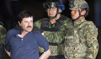 """Joaquin """"El Chapo"""" Guzman is made to face the press as he is escorted to a helicopter in handcuffs by Mexican soldiers and marines at a federal hangar in Mexico City, Mexico, Friday, Jan. 8, 2016. Mexican President Enrique Pena Nieto announced that Guzman had been recaptured six months after escaping from a maximum security prison. (AP Photo/Eduardo Verdugo)"""