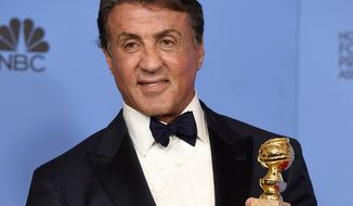 "Sylvester Stallone poses in the press room with the award for best performance by an actor in a supporting role in a motion picture for ""Creed"" at the 73rd annual Golden Globe Awards on Sunday, Jan. 10, 2016, at the Beverly Hilton Hotel in Beverly Hills, Calif. (Photo by Jordan Strauss/Invision/AP)"