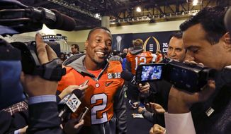 Clemson cornerback Mackensie Alexander talks during media day for the NCAA College Football Playoff National Championship in Phoenix, Saturday, Jan. 9, 2016. Clemson will face Alabama in Monday's game. (AP Photo/David J. Phillip)