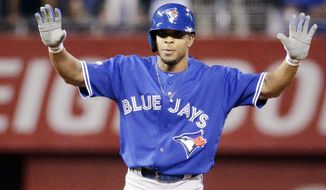 Toronto Blue Jays' Ben Revere celebrates a double against the Kansas City Royals during the first inning in Game 6 of baseball's American League Championship Series on Friday, Oct. 23, 2015, in Kansas City, Mo. (AP Photo/Charlie Riedel)
