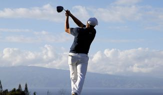 Jordan Spieth hits from the 18th tee during the final round of the Tournament of Champions golf tournament, Sunday, Jan. 10, 2016, at Kapalua Plantation Course on Kapalua, Hawaii. Spieth finished 30 under par for the tournament win. (AP Photo/Matt York)