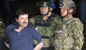 "In this Friday, Jan. 8, 2016 photo, Joaquin ""El Chapo"" Guzman is made to face the press as he's escorted to a helicopter in handcuffs by soldiers and marines at a federal hangar in Mexico City. Guzman's second prison escape in 2015 from a top security prison though a tunnel had embarrassed President Enrique Pena Nieto and made his capture a national priority. (AP Photo/Eduardo Verdugo)"