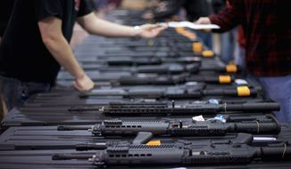 There were 91 arrests stemming from gun shows to go along with the 278 sales that were halted, out of a total of 35,535 transactions, according to the Virginia Firearms Transaction Center. (Associated Press)