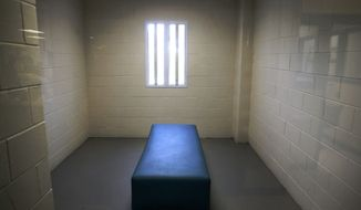 In this Thursday, June 26, 2014, photo is an empty room in in the Cook County Jail's infirmary's within the Cermak Health Services second floor psychiatric facility, the landing place for inmates with the most pressing mental health needs in Chicago. (AP Photo/Charles Rex Arbogast)