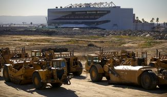 FILE - In this Dec. 18, 2015, file photo, construction is underway on the former Hollywood Park site in Ingewood, Calif., where St. Louis Rams owner Stan Kroenke proposes to build an NFL stadium. The Rams' relocation application says the NFL would benefit from the team's move to Los Angeles, leaving behind a lagging St. Louis market and a stadium proposal doomed for failure. Rams owner Stan Kroenke has proposed building a $1.8 billion stadium in Inglewood, California, with plans to put the Rams back in the market they left to move to St. Louis in 1995. (Mark Boster/Los Angeles Times via AP)  NO FORNS; NO SALES; MAGS OUT; ORANGE COUNTY REGISTER OUT; LOS ANGELES DAILY NEWS OUT; INLAND VALLEY DAILY BULLETIN OUT; MANDATORY CREDIT, TV OUT
